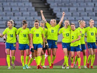 Stina Blackstenius celebrates with teammates.