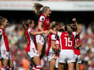 Arsenal celebrate after scoring.