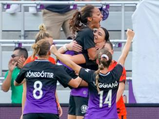 Orlando Pride players celebrate Taylor Kornieck's goal.