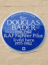 Image of blue plaque with the text Sir Douglas Bader 1910-1982 RAF Fighter Pilot lived here 1955-1982. Copyright Wikipedia Commons