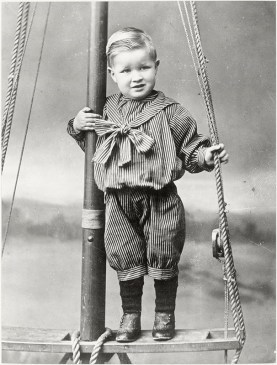 3-year old George Hooper, standing on a piece of timber in the rigging of a sailing boat, c1896? (http://bit.ly/2AWlsgG)