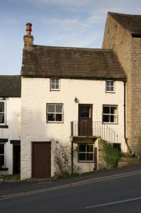 In the heart of Alston, an urban version of the bastle tradition, with a separate entrance for first floor accommodation. The ground floor is likely to have had many different uses over the years, depending on need