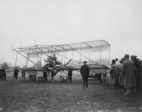 EGP 22662/53, Claude Grahame-White at the controls of his Farman biplane with a passenger, at the Bournemouth Aviation meeting, July 1910