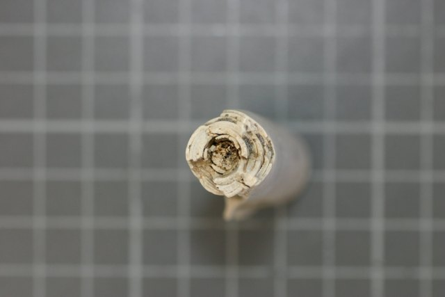Candle fragment, showing fibrous wick in the centre