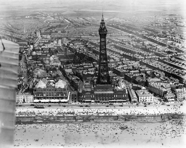 This Aerofilms photograph of 1920 shows the Tower with the Giant Wheel of the Winter Gardens behind. It was removed in 1928, but the Tower, which bears the sign 'Wonderland of the World' is still a thrill for all visitors to Britain's most popular resort. EPW002080