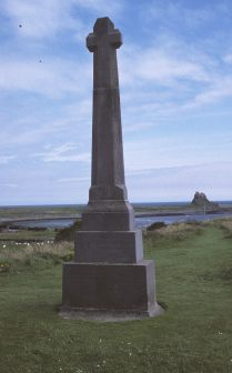 One of 15 War Crosses designed by Lutyens, this memorial stands in a wild and beautiful location on The Heugh overlooking Lindesfarne Castle - which Lutyens renovated - with the ruins of Lindesfarne Priory to the south and the Farne Islands in the distance to the east. Lutyens, who waived his fee, chose Doddington stone to be in harmony with the stone of the castle. The memorial was unveiled on 4 June 1922. Hurricane force winds in the winter of 1983-84 damaged the shaft of the cross. The top of the memorial was then replaced. Photo courtesy of Tim Skelton