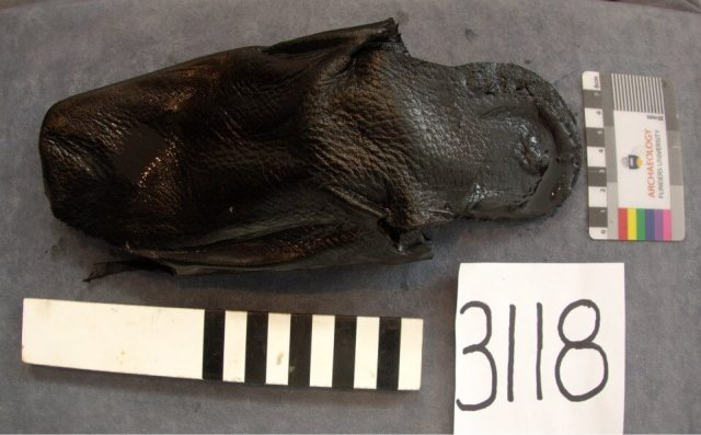 One of many leather shoes recovered from the London illustrating the excellent levels of preservation on the site. © Ste