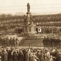 Unveiling of the memorial 15 October 1922. Image courtesy Hugh Hollinghurst/Liverpool Echo. The heroic lifesize bronze figures of this memorial are strikingly symbolic. The mother and child represent the motherland and the future generations of the then British Empire, guarded by the three great fighting forces - army, navy and air force - which protected the country during the First World War. The inclusion of the highly detailed figure of the airman - pulling on his gloves while looking skyward - is relatively uncommon on war memorials and indicates the growing importance of the air services during the conflict.