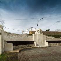 Aviators' Memorial, Eastchurch, Kent. Unveiled 25 July 1955. Newly listed at Grade II. Image © Historic England. This memorial, with its central figure of Zeus god of thunder, marks the outstanding impact of the Royal Aero Club - based at Eastchurch and Leysdown Flying Grounds - on the development of aviation in Britain. It features representational reliefs of early aircraft, the names of pioneering and celebrated early aviators, designers and constructors connected to the site and a carved bust of an aviator fully dressed in flying gear.