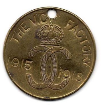 A tally disc worn by staff when they were at work in the factory, each with its own unique number - a vital way of knowing who was on site should there be an emergency. The words 'The VC Factory' refer to the popular but unrealised call that the factory itself should be awarded a Victoria Cross. © Royal Armories.