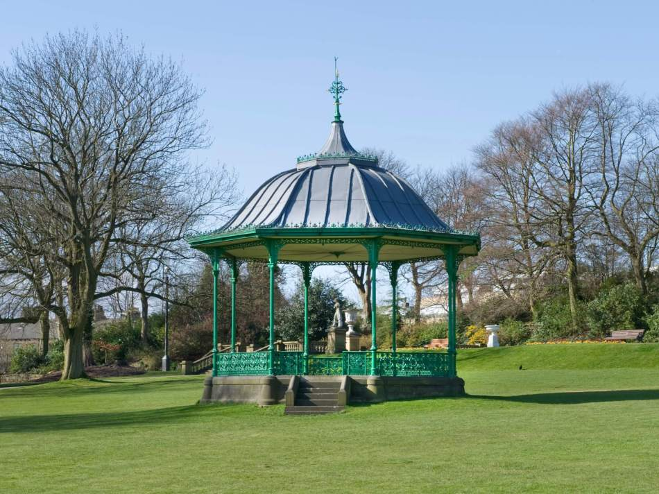 The bandstand in People's Park, Halifax in the foreground of trees