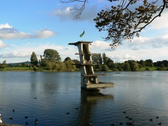 Art deco diving board in the middle of a body of water