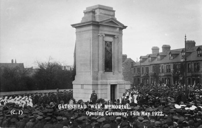 A crowd gathers around Gateshead War Memorial for its unveiling