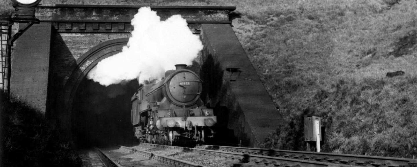A steam train emerges from Ipswich Tunnel