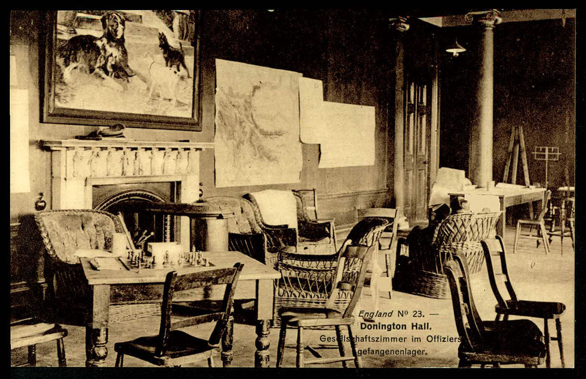 View of common room with multiple mismatched chairs and a table with a chess set on it