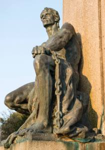 Exeter memorial detail - a male figure in chains