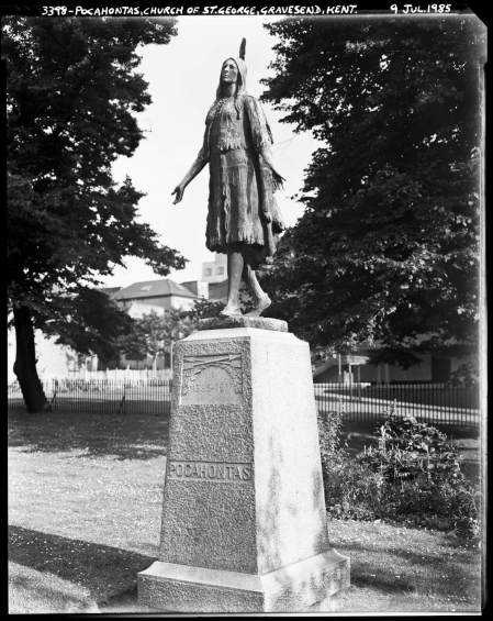 An almost life-size image of Pocahontas, with a feathered headdress, stands atop a plinth that reads 'POCAHONTAS'