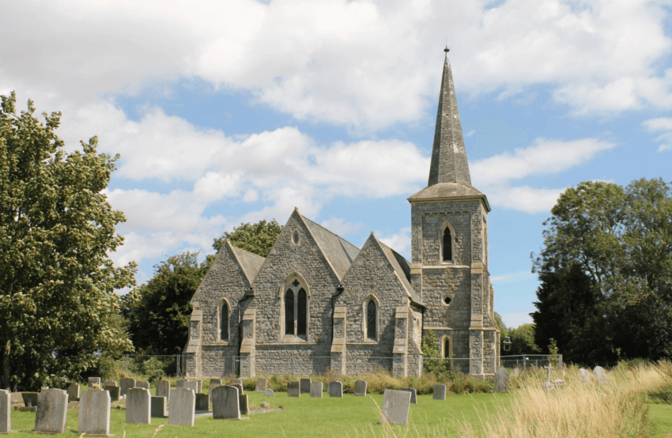 Exterior of church with gravestones in the foreground