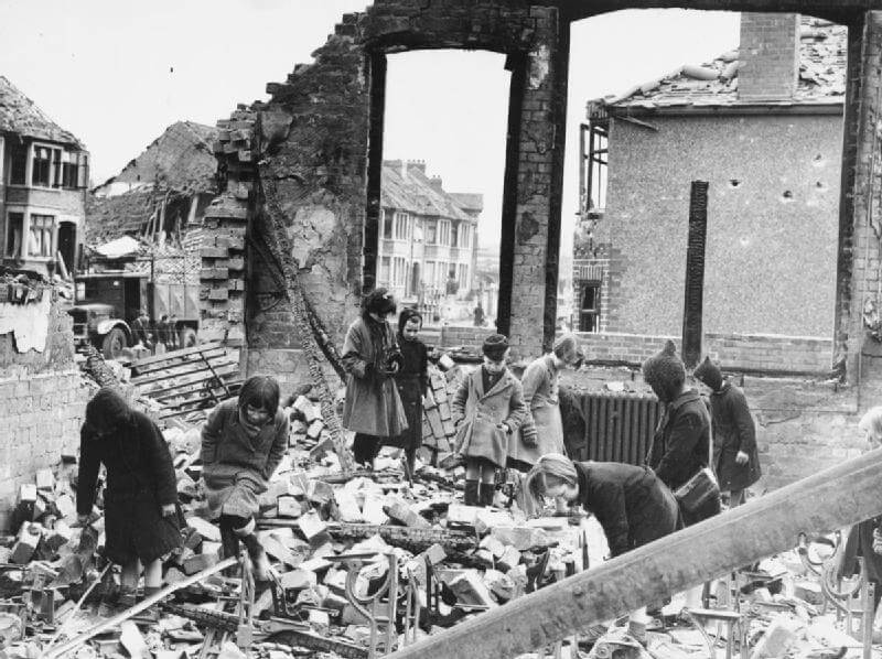 Children searching for books among the ruins of their school in Coventry after a Luftwaffe bombing raid