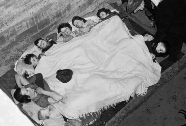 Seven children from the O'Rourke family sleeping with their mother in an air raid shelter