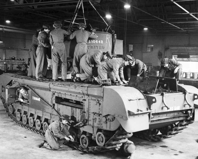 ATS mechanics manoeuvring a turret onto a Churchill tank at a Royal Army Ordnance Corps Depot