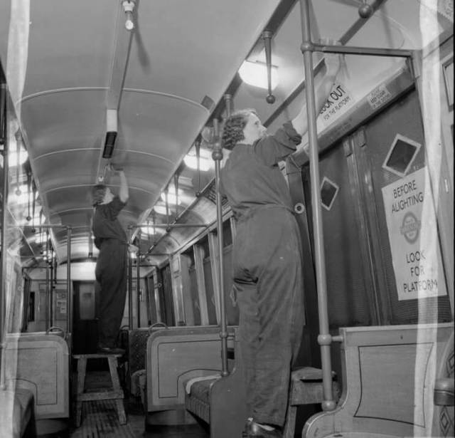 Sisters Ivy Sumter and Betty Bostock clean a tube train