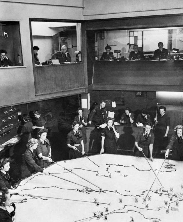 WAAF plotters and duty officers at work in the Operations Room at RAF Fighter Command's No. 10 Group Headquarters, Rudloe Manor, Wiltshire, 1943
