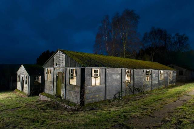Two huts at night at Harperely prison of war camp