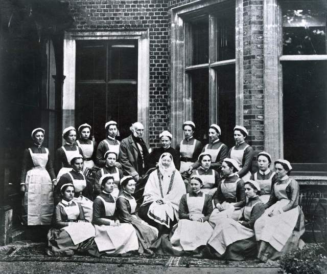 Florence Nightingale (centre) with her brother-in-law Sir Henry Verney - once her suitor - and a group of nurses from the Nightingale Training School