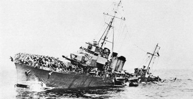 The French destroyer Bourrasque, loaded with rescued troops, sinking.