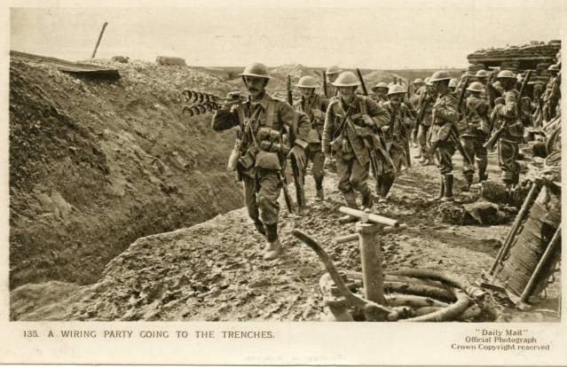 A wiring party of British troops wearing tin hats