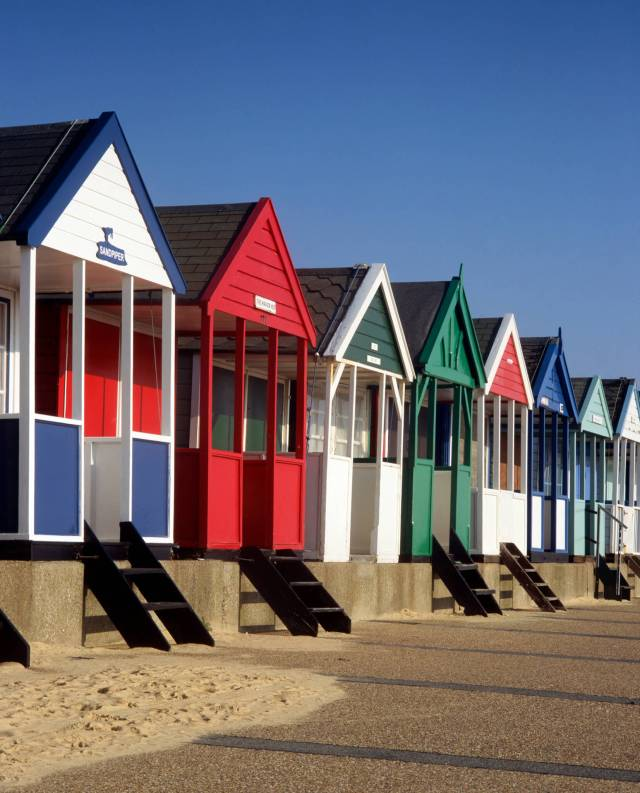 Beach huts in Southwold, Suffolk © Historic England Archive