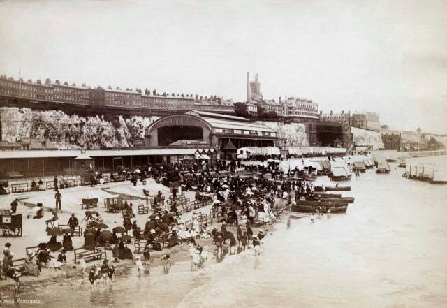 A busy beach beside the railway station © Historic England Archive OP29135