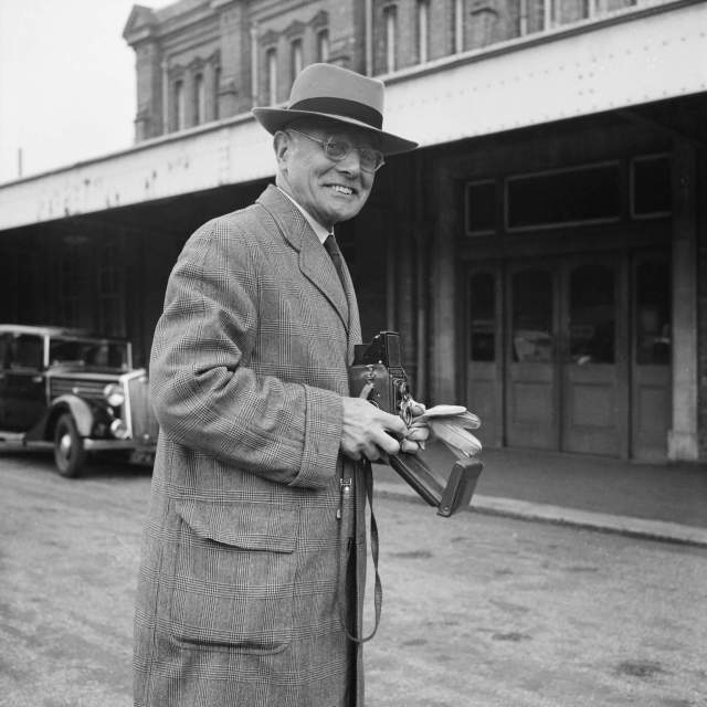 Chairman and owner of the company, John Laing, with a Rolleiflex camera
