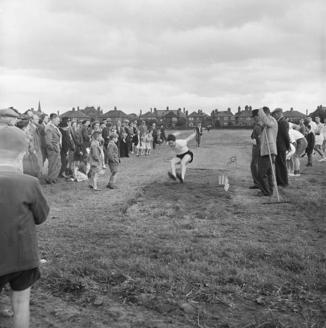 Spectators watching the long jump during a Sports Day