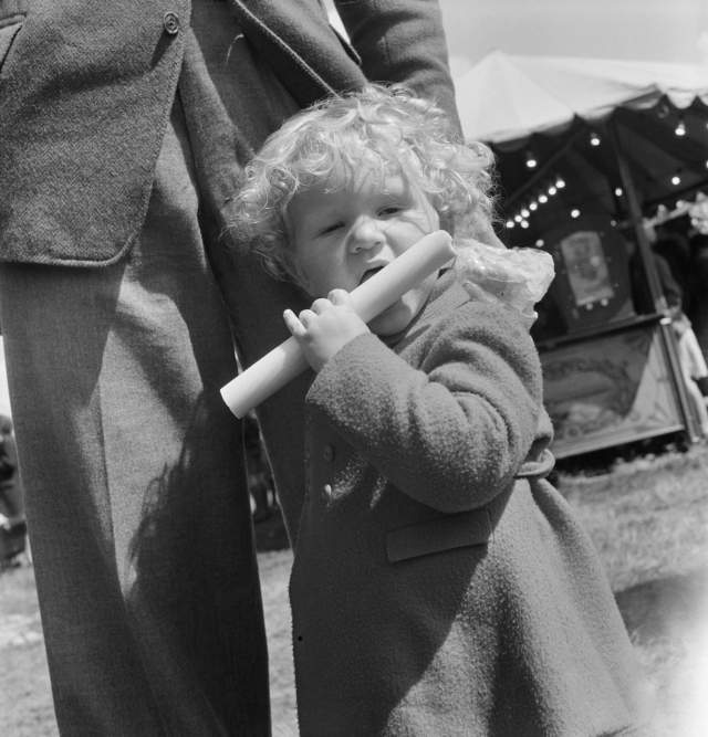 A child eating a stick of rock