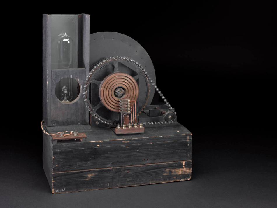 John Logie Baird's television receiving apparatus. The large disc, perforated with 30 holes in a spiral (a 'Nipkow' disc), rotates at the same time as a picture-scanning disc at the transmitting end.