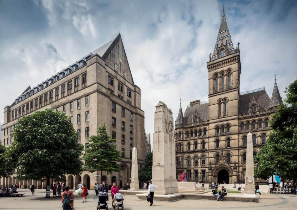 Manchester Town hall (right back) is regarded as one of the finest interpretations of Gothic revival architecture in the world (1868-1877) Grade I listed © Historic England Archive