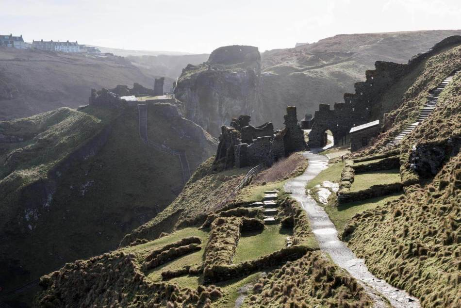 Landscape photograph of an eroding Tintagel Castle on a gloomy day.