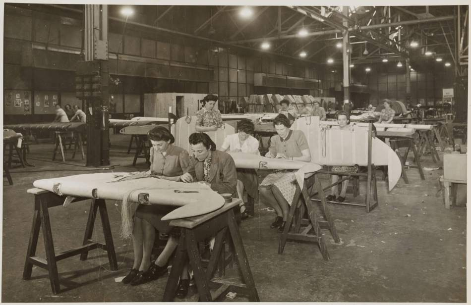 Women workers sewing and lacquering the Spitfire rudders