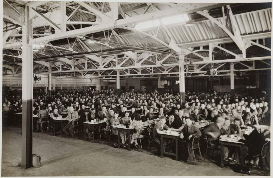 Male and females workers in the canteen