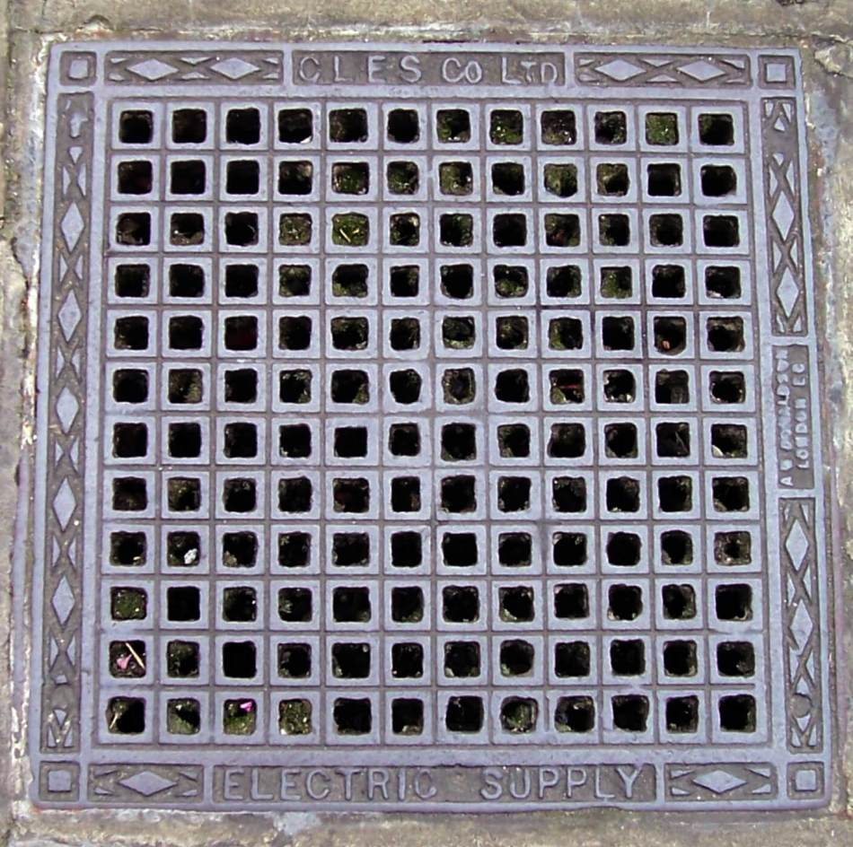 A square manhole with holes.
