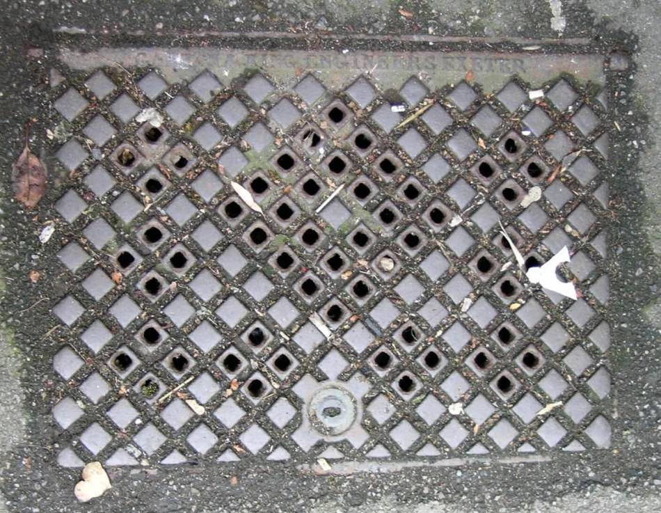 Manhole cover with holes for ventilation.