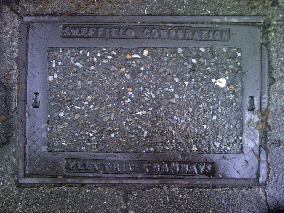 Manhole cover with 'Sheffield Corporation Electric Tramways' text.
