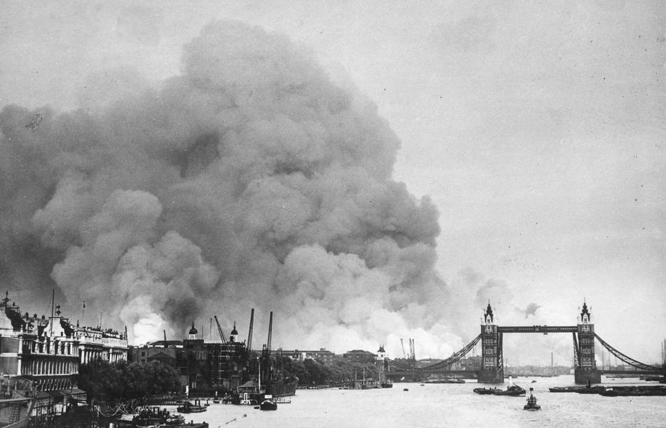 Smoke above the Tower of London and Tower Bridge.