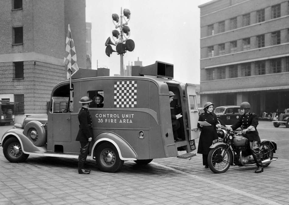 Women firefighters with a van with 'Control Unit 35 Fire Area' on the side.