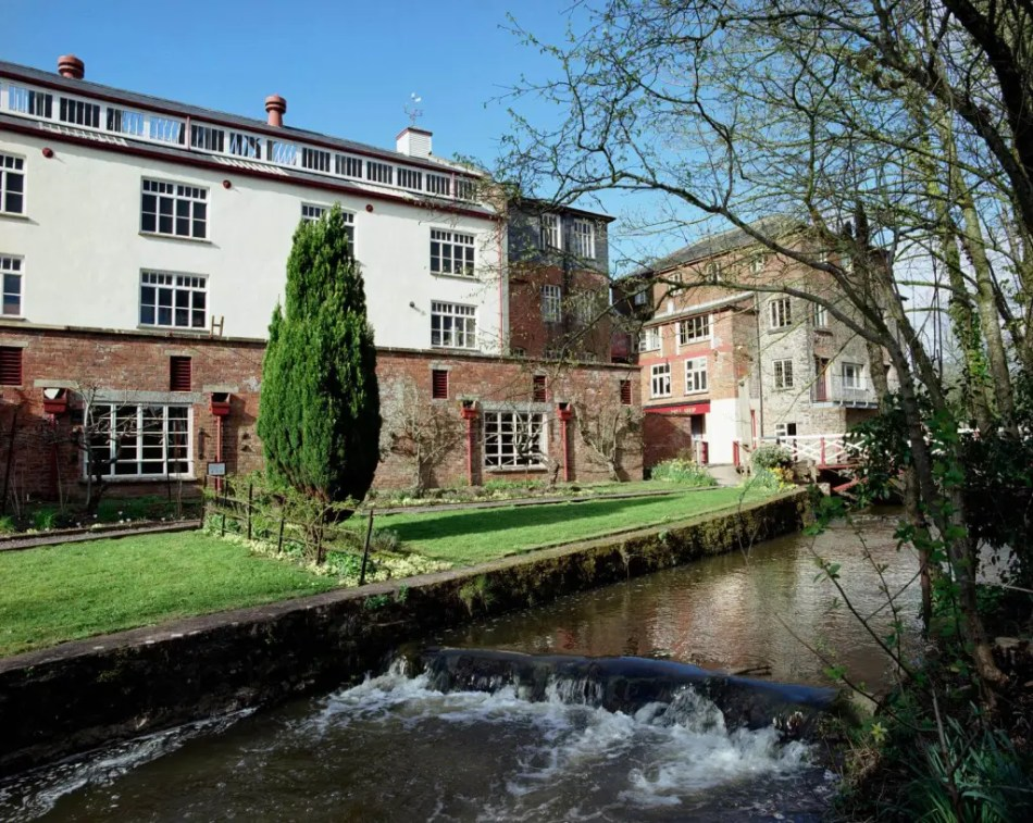 Exterior of Coldharbour Mill with stream in forefront