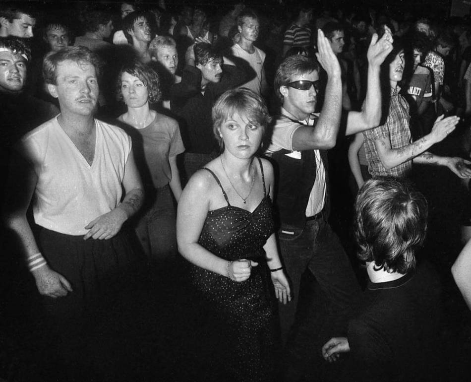 Dancer's in a club in late 1970s or early 1980s clothing.