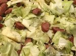 cabbage cooking in skillet with kielbasa