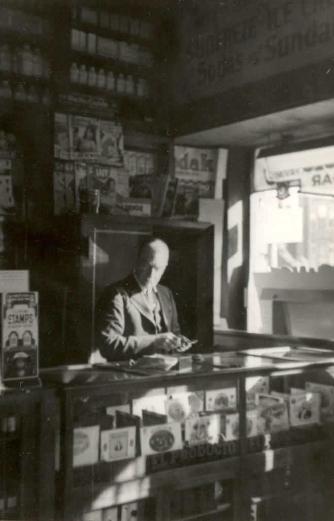Samuel J. Lee in His Drugstore in St. Louis, Missouri, possibly 1940s or 1950s?